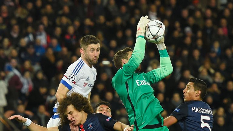 Kevin Trapp catches the ball above Gary Cahill