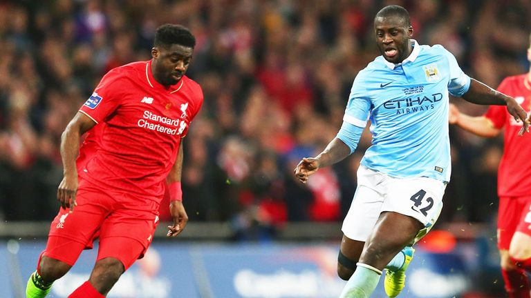 Liverpool defender Kolo Toure challenges brother Yaya Toure of Manchester City
