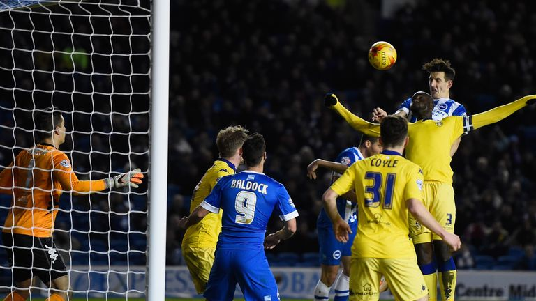 Lewis Dunk heads in Brighton's fourth goal