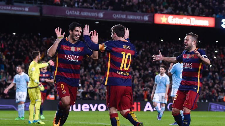 Luis Suarez celebrates with Lionel Messi after the penalty routine