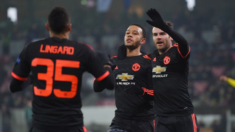 Memphis Depay celebrates scoring his goal with Jesse Lingard and Juan Mata