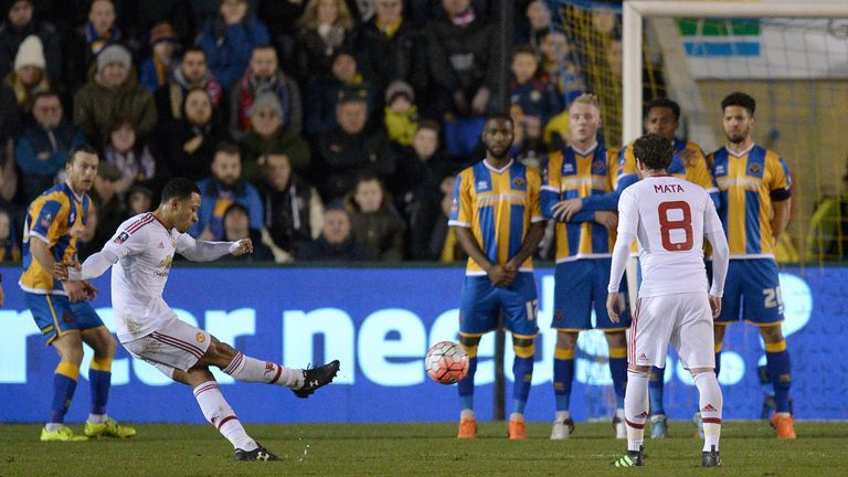 Memphis Depay strikes a first-half free-kick on goal