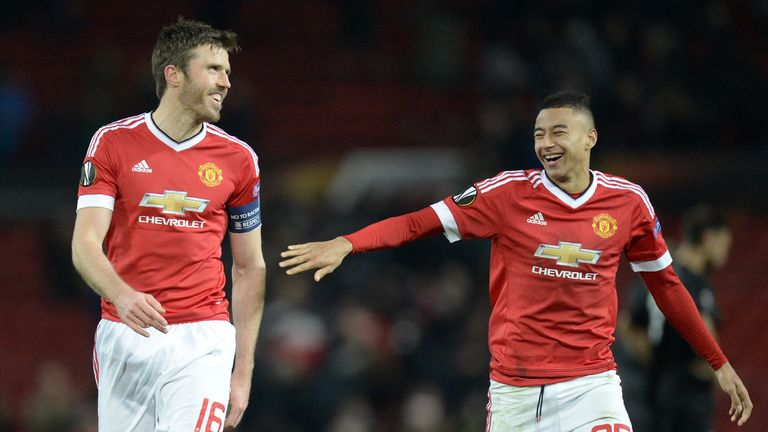 Michael Carrick (left) shares a joke with Jesse Lingard