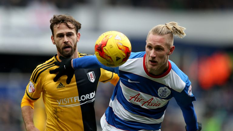 Fulham's Michael Madl and Queens Park Rangers' Sebastian Polter (right) battle for the ball