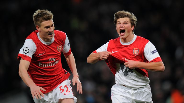 Nicklas Bendtner and Andrey Arshavin celebrate scoring the winner against Barcelona in 2011