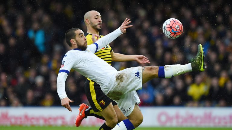 Giuseppe Bellusci of Leeds and Amrabat compete for the ball