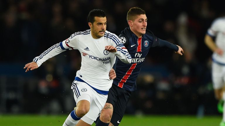 Pedro and Marco Verratti battle for the ball