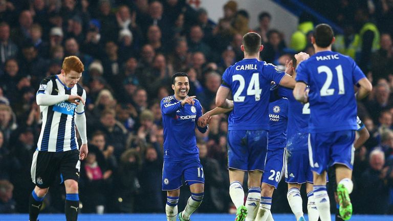 Pedro (2nd L) of Chelsea celebrates scoring his team's fourth goal