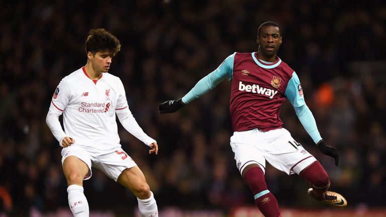 Pedro Obiang is tracked by Joao Teixeira