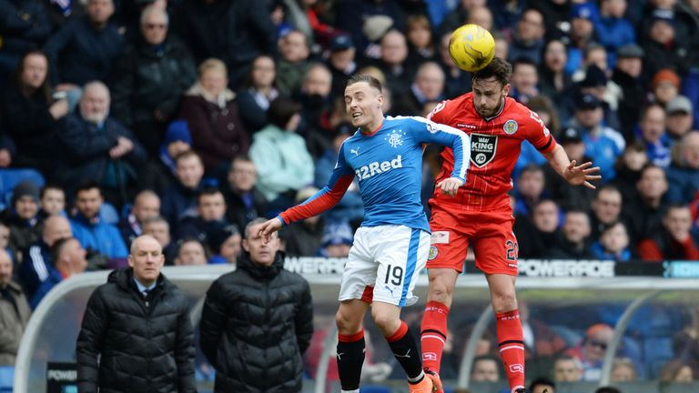 Barrie McKay (left) goes in for the aerial challenge against Keith Watson