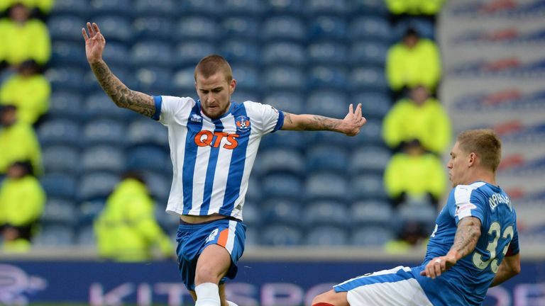Craig Slater skips away from Martyn Waghorn as both sides battle for the breakthrough