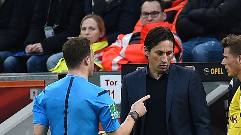 Referee Felix Zwayer (left) talks to Bayer Leverkusen head coach Roger Schmidt