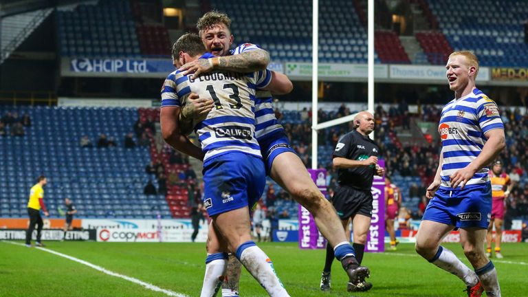 Josh Charnley celebrates his late try with Sean O'Loughlin