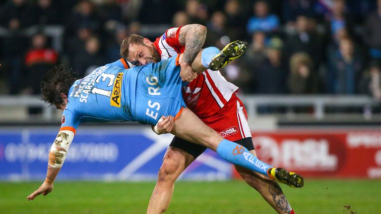 Josh Griffin tackles St Helens' Louie McCarthy-Scarsbrook
