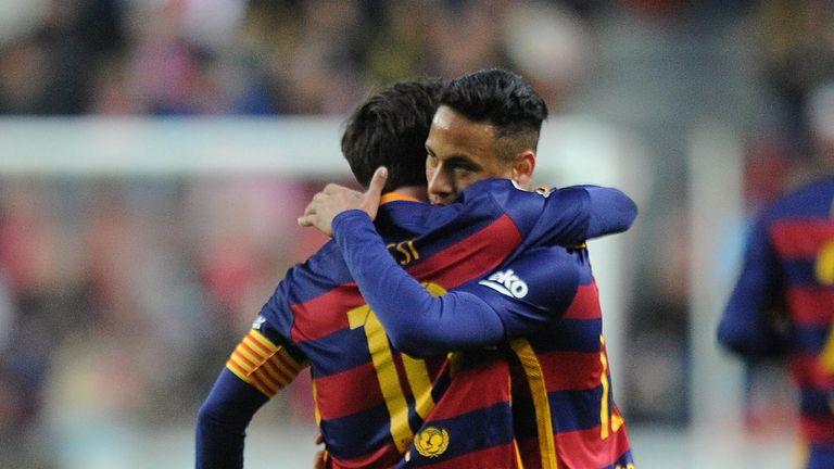 Lionel Messi celebrates with Neymar.