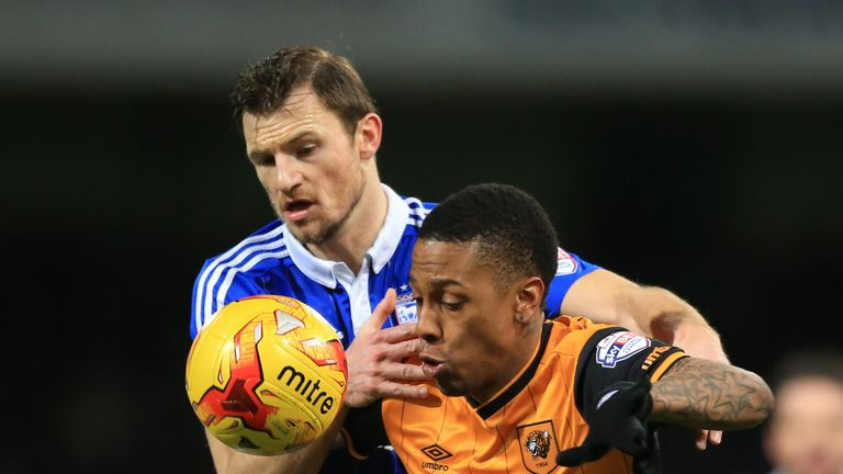 Tommy Smith and Abel Hernandez battle for the ball