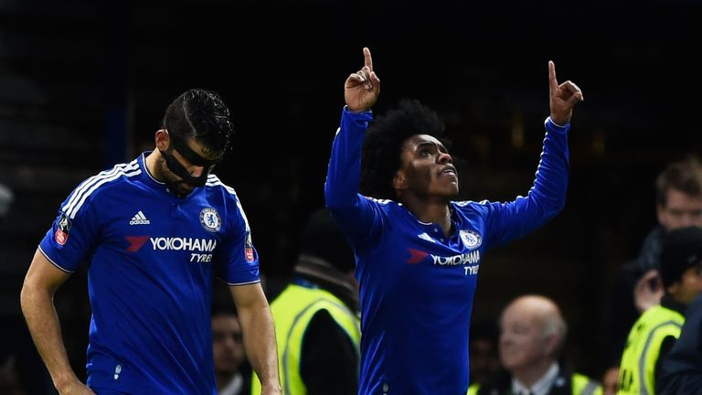 Willian (right) slide home Chelsea's third goal to put them on their way