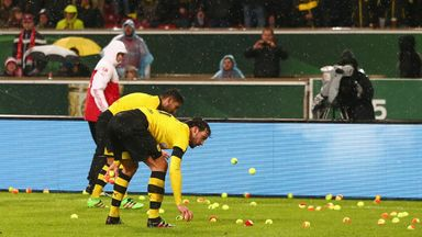 Both sets of players removed tennis balls thrown by Dortmund fans