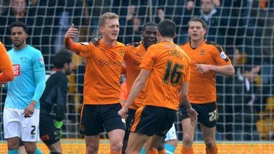 George Saville celebrates scoring for Wolves