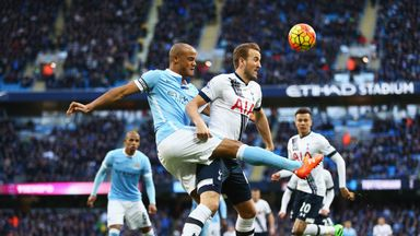 Harry Kane is challenged by Vincent Kompany