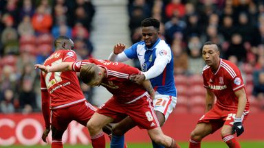 Hope Akpan is crowded out by Middlesbrough players