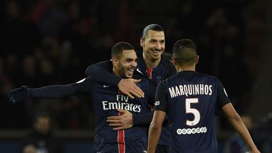 Layvin Kurzawa (left) is congratulated by Zlatan Ibrahimovic and Marquinhos
