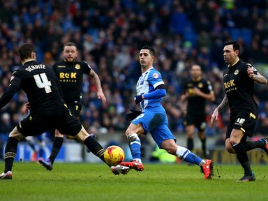 Beram Kayal of Brighton holds off the Bolton defence to play a through ball
