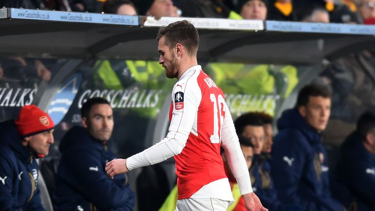 Aaron Ramsey leaves the field with injury during the FA Cup win over Hull