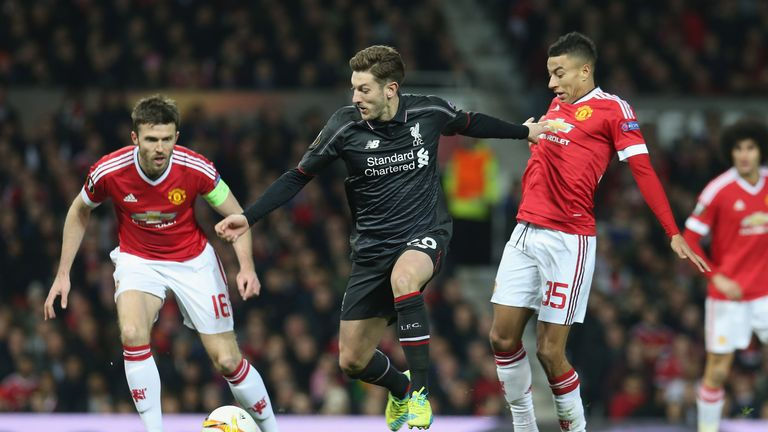 Adam Lallana tries to find space