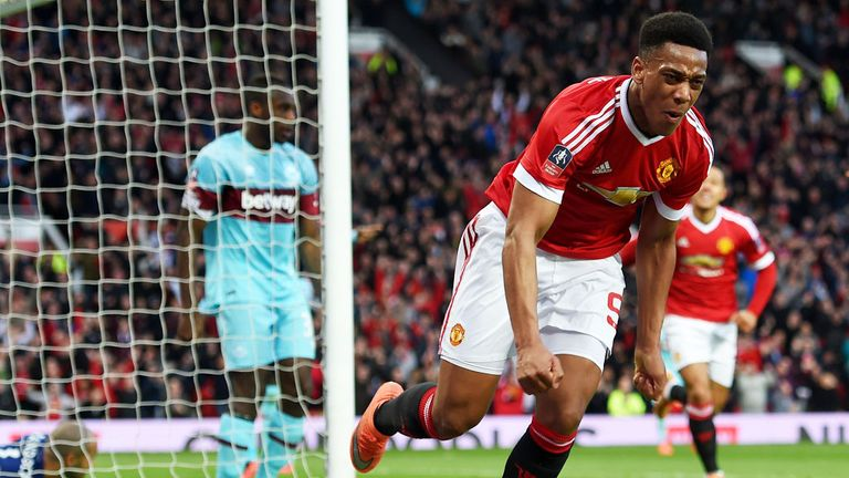 Anthony Martial wheels away after netting against West Ham