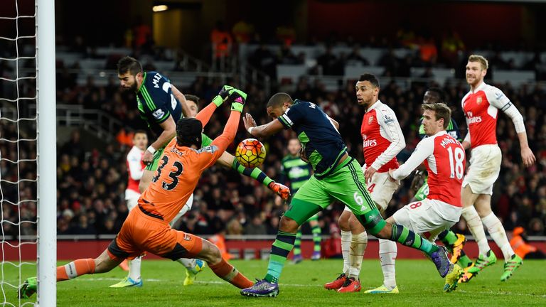 Petr Cech cannot stop the Swansea skipper scoring