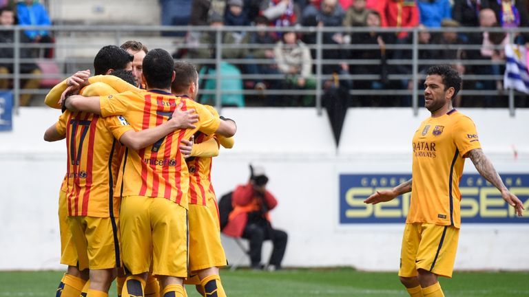 Barcelona defender Dani Alves (R) joins his teammates as they celebrate after scoring against Eibar