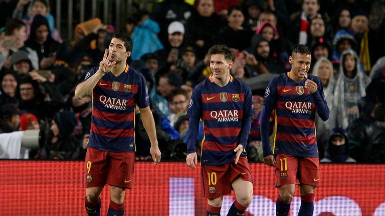 Luis Suarez celebrates with Lionel Messi and Neymar
