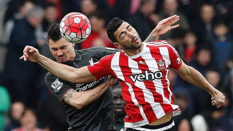 Dejan Lovren (left) and Graziano Pelle compete for the ball