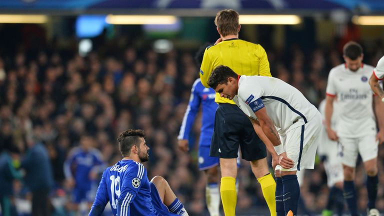 Chelsea striker Diego Costa (left) goes down injured on the pitch