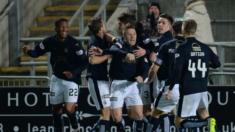 Falkirk's Myles Hippolyte (left) celebrates with his team-mates after bringing his side level against Rangers
