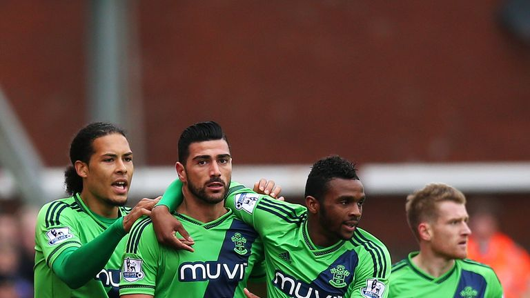 Graziano Pelle (second left) is congratulated after opening the scoring