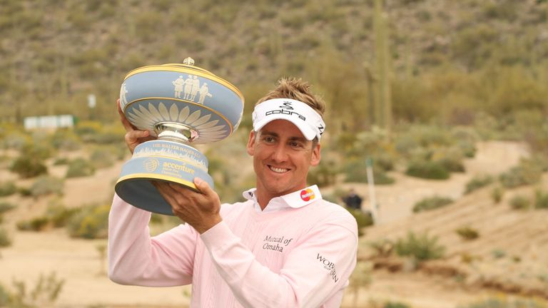 Poulter lifts the trophy following his Match Play success in 2010