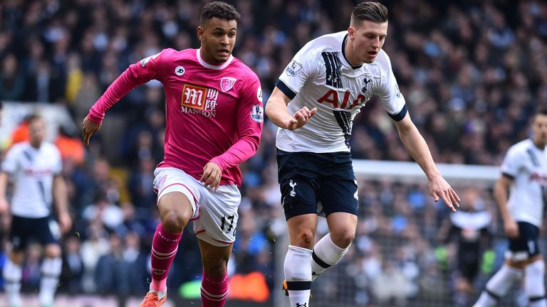 Joshua King and Kevin Wimmer compete for the ball