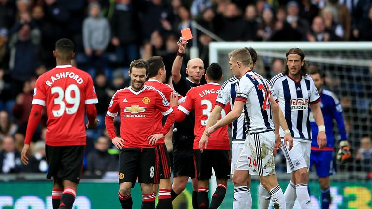 Mike Dean sends Manchester United's Juan Mata off