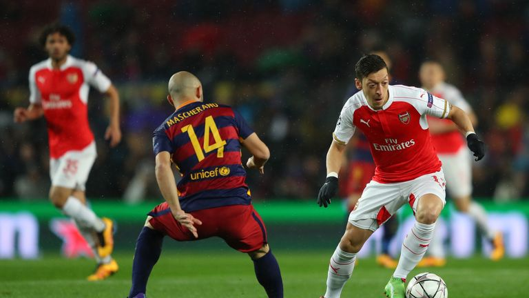 Mesut Ozil in action in the first half for Arsenal