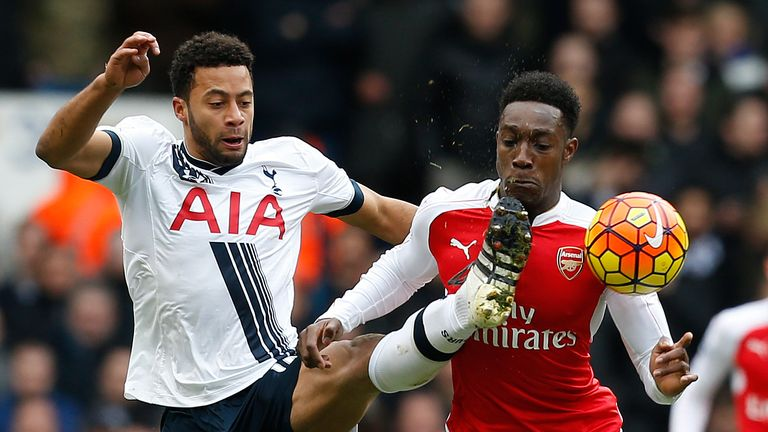 Mousa Dembele tussles with Danny Welbeck in the first-half at White Hart Lane