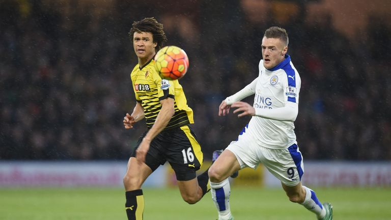 Jamie Vardy and Nathan Ake compete for the ball