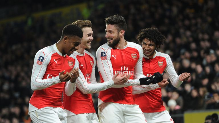 Olivier Giroud celebrates scoring a goal for Arsenal with Alex Iwobi, Calum Chambers and Mohamed Elneny