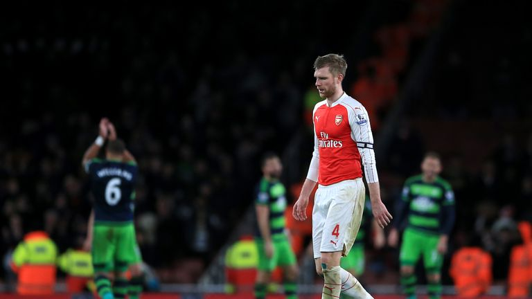 Arsenal's Per Mertesacker is left dejected after the final whistle