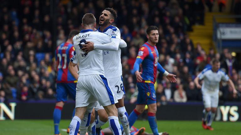 Riyad Mahrez celebrates with Jamie Vardy during a vital win over Crystal Palace