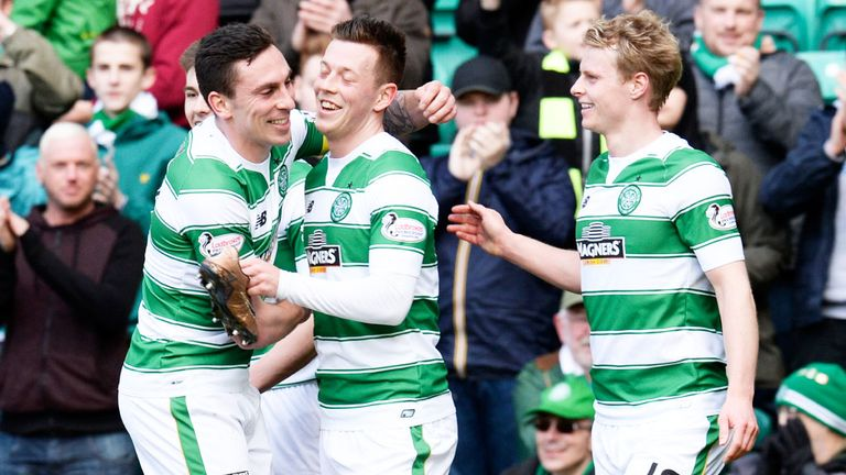 Callum McGregor (centre) is congratulated after scoring Celtic's third goal