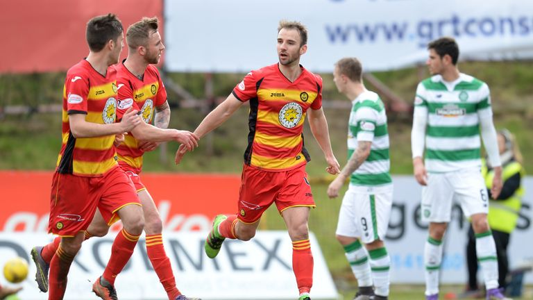 Partick midfielder Sean Welsh (middle) celebrates scoring from the spot