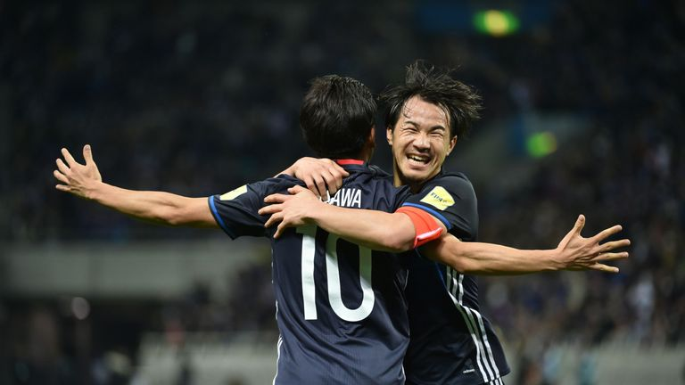 Kagawa celebrates with Shinji Okazaki during Japan's 2018 World Cup qualifying win