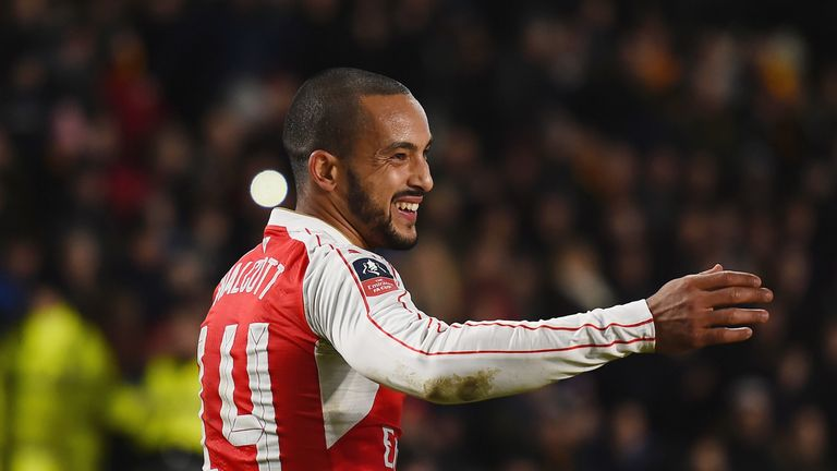 Theo Walcott scored twice after setting Giroud up for his second